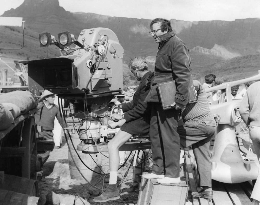Director Cy Endfield with one of the huge cameras used for the Zulu shoot. The film was shot in the Technirama, an anamorphic, widescreen technology similar to CinemaScope. Other recent Technirama productions included El Cid (1961) and The Leopard (1963).