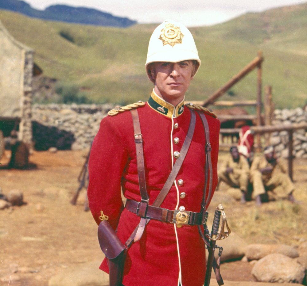 All dressed up for stardom: Caine poses in uniform for a portrait between takes. He quickly found himself one of the biggest actors in 1960 British cinema, after his star-making turn here playing infantry officer Lieutenant Gonville Bromhead.