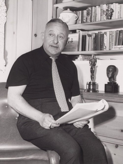 Producer Arthur Freed, with his Oscar for An American in Paris in the background
