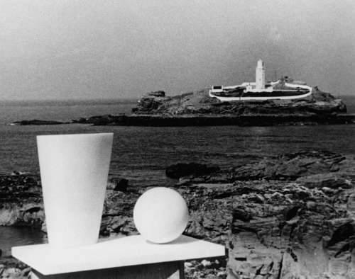 Production still from Figures in a Landscape (1953) with Hepworth's Conoid, Sphere and Hollow 1937