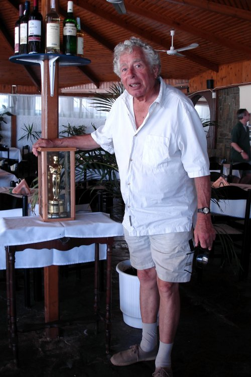 Walter Lassally with the Oscar he won for best blanc and white cinematography on Michael Cacoyannis' Zorba the Greek in 1964, in his local taverna in Crete in 2006.