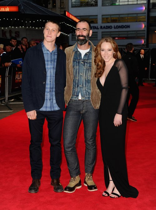 Actors George Mackay and Charlotte Spencer and director Duane Hopkins (centre) attend the red carpet arrivals of Bypass during the 58th BFI London Film Festival