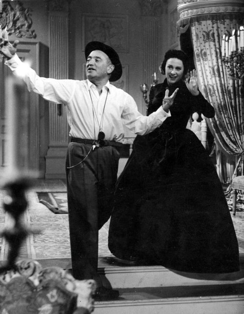 Max Ophuls directing Martine Carol on the set of Lola Montès (1955)