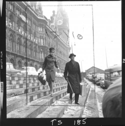 Contact sheet for The Servant (1963) showing Sarah Miles and Dirk Bogarde outside St Pancras station
